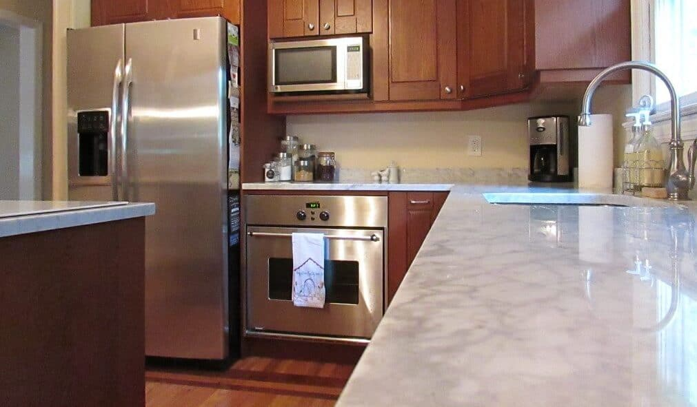 oven-cleaner-on-marble-kitchen-countertops